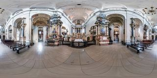 VILNIUS, LITHUANIA - MAY 2019: Full spherical seamless hdri panorama 360 degrees angle inside interior of old baroque catholic. Church of all saints in royalty free stock photo