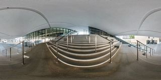 VILNIUS, LITHUANIA - MAY, 2019: Full spherical seamless panorama 360 degrees angle near facade of crooked modern building with stock images