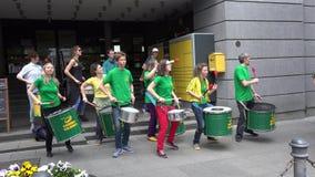 Joyful musicians play and dance samba rhythm with drums on street. stock video footage