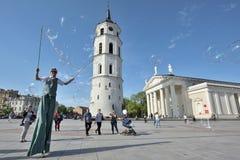 Street artist makes big soap bubbles. Vilnius, Lithuania, May 4: Unknown street artist makes big soap bubbles in a public square on May 4, 2018 in Vilnius Stock Photo