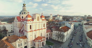 VILNIUS, LITHUANIA - NOVEMBER, 25, 2015; Beautiful aerial footage of Church of St. Casimir and landscape of Vilnius old town. Nove stock video footage