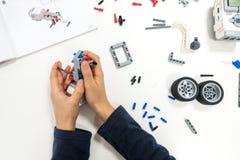 Vilnius, Lithuania - November 16, 2018: Kid making Lego robot mindstorms. Robotic, learning, technology, stem education. Vilnius, Lithuania - November 16, 2018 royalty free stock photo