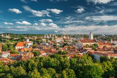 Vilnius, Lithuania. Old Town Historic Center Cityscape Under Dramatic Sky. And Bright Sun In Sunny Summer Day. Travel Panorama. UNESCO World Heritage. Famous Stock Photo