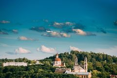 Vilnius, Lithuania. Plane Flying Over Church Of The Ascension And Church Of The Sacred Heart Of Jesus Among Green Stock Photos