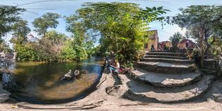VILNIUS, LITHUANIA SEPTEMBER 2018, Full seamless 360 degrees angle view panorama on concrete steps near river and place of power royalty free stock photo