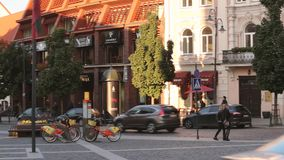 Vilnius, Lithuania. View Of Spacious Rest Zone On Didzioji Street, Ancient Showplace In Old Town With Outdoor Cafe. Pan. Vilnius, Lithuania - September 29, 2017 stock footage
