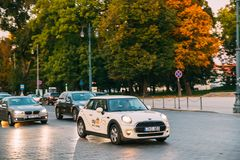 White Color Car Mini Cooper With Logo Citybee Moving On Street. Vilnius, Lithuania - September 29, 2017: White Color Car Mini Cooper With Logo Citybee Moving On Royalty Free Stock Photos