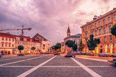Vilnius, Lithuania: the Town Hall Square, Lithuanian Vilniaus rotuses aikste. In the sunrise Royalty Free Stock Image