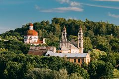 Vilnius, Lithuania. View Of Church Of The Ascension And Church Of The Sacred Heart Of Jesus Among Foliage. Royalty Free Stock Photography