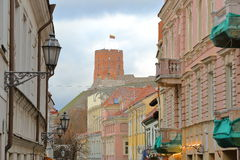 VILNIUS, LITHUANIA: View of Gediminas Hill with the colorful facades of Pilies Street in the foreground. View of Gediminas Hill with the colorful facades of royalty free stock photo