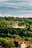 Vilnius, Lithuania. View Of Old Catholic Church Of Ascension Among Green Foliage Stock Images
