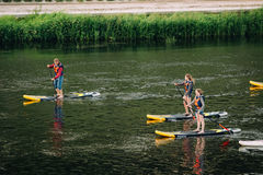 Vilnius, Lithuania. Young People Stand Up Paddling SUP Or Standu Royalty Free Stock Photos