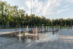 VILNIUS, LITUANIA - JULY 27, 2018: Kids Are Playing in Lukiskies Square Vilnius with Fountain and Water. Local Attraction for Chil. Kids Are Playing in Lukiskies royalty free stock photography