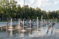 VILNIUS, LITUANIA - JULY 27, 2018: Kids Are Playing in Lukiskies Square Vilnius with Fountain and Water. Local Attraction for Chil. Kids Are Playing in Lukiskies stock photo