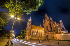 Vilnius night church. Saint Anne Church in Vilnius, Lithuania. Night scene of lovely Europe town, wide angle Stock Photo