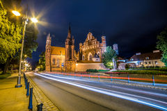 Vilnius at night. Saint Anne Church in Vilnius, Lithuania. Night scene of lovely Europe town, wide angle Royalty Free Stock Photo