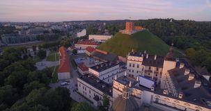 Vilnius Old Town Cathedral Square and Hill of Three Crosses in Background. Lithuania. Sunset Time Light stock video footage