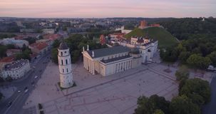 Vilnius Old Town Cathedral Square and Hill of Three Crosses in Background. Lithuania. Sunset Time Light stock footage