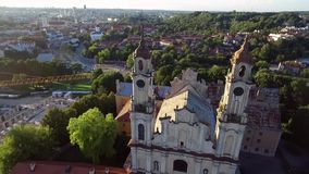 Vilnius old town with church of the Ascension and Uzupis Republic in Background.  stock footage