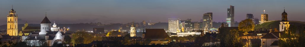 Vilnius old town night panorama with beautiful illuminated buildings. Churches castle, modern glass office buildings. Old, medieval view of the modern city stock photos