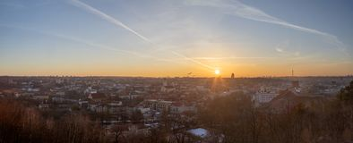Vilnius old town panorama late evening at cold winter day. Vilnius old town panorama at cold winter evening. Red tiled roofs, golden tops of towers, churches royalty free stock photos