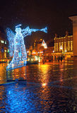 Vilnius Old Town Square at Christmas time. Illuminated angel figure at Vilnius Old Town Square at Christmas night. Vilnius, Lithuania Royalty Free Stock Image