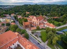 Vilnius Old Town and St. Anne Church with Hill of Three Crosses in Background. Lithuania. Sunset Time Light. Royalty Free Stock Photos