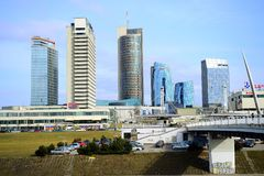 Vilnius spring panorama with skyscrapers on Neris river board Stock Photography