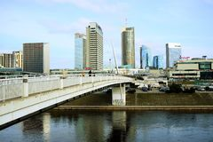 Vilnius spring panorama with skyscrapers on Neris river board Royalty Free Stock Photography