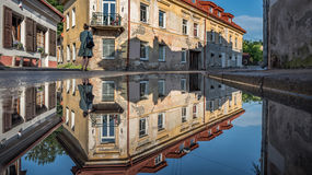 Vilnius Uzupis Republic. One of the most popular sightseeing place in Lithuania. Old Buildings and Reflection on Water. Vilnius Ol Stock Photo