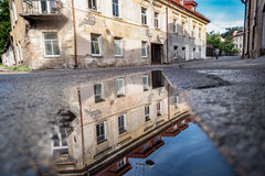 Vilnius Uzupis Republic. One of the most popular sightseeing place in Lithuania. Old Buildings and Reflection on Water. Vilnius Ol Royalty Free Stock Photo