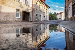 Vilnius Uzupis Republic. One of the most popular sightseeing place in Lithuania. Old Buildings and Reflection on Water. Vilnius Ol Royalty Free Stock Photos