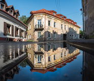 Vilnius Uzupis Republic. One of the most popular sightseeing place in Lithuania. Old Buildings and Reflection on Water. Vilnius Ol Royalty Free Stock Images