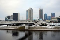 Vilnius winter panorama with skyscrapers on Neris river board Stock Photo