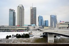 Vilnius winter panorama with skyscrapers on Neris river board Royalty Free Stock Images