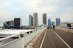 Vilnius winter panorama with skyscrapers on Neris river board Stock Photos