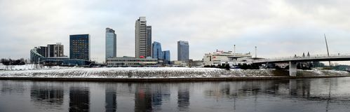 Vilnius winter panorama with skyscrapers on Neris river board Stock Photography