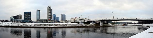 Vilnius winter panorama with skyscrapers on Neris river board Royalty Free Stock Photography