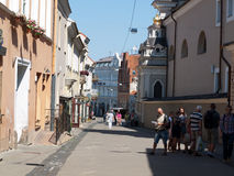 Vilnus, Lithuania. Vilnius, Lithuania - May 23, 2014: Tourists visit one of the most popular Pilies street of the old town on May 23,  2014 in Vilnius, Lithuania Stock Photography