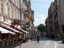 Vilnus, Lithuania. Vilnius, Lithuania - May 23, 2014: Tourists visit one of the most popular Pilies street of the old town on May 23,  2014 in Vilnius, Lithuania Stock Photos