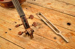 Viloin and tuning fork still life Stock Image