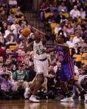 Vin Baker and Kurt Thomas. Boston Celtics forward Vin Baker is defended by Knicks forward Kurt Thomas 40.  Image taken from color slide Royalty Free Stock Images
