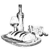 Vin, bröd och ädelost Arkivfoto