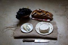 Vin, bröd och ost Arkivbild