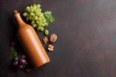 Vin, druva och muttrar arkivbild