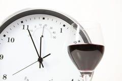Vin et horloge d'isolement Image stock