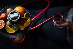 Vin et narguilé Photographie stock