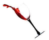 Vin rouge avec une éclaboussure Photos libres de droits