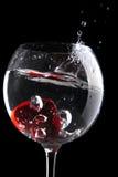 vin rouge de gelée en verre de coeur Photographie stock