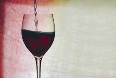 Vin rouge en glace image libre de droits